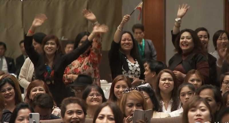 TOKYO. Some Filipino women in Tokyo, Japan wave their hands when President Rodrigo Duterte mentioned that he wanted to kiss some women as long as they are willing and not married. Duterte met with the Filipino community in Japan on Thursday, May 30, 2019. (Photo from Palace video)