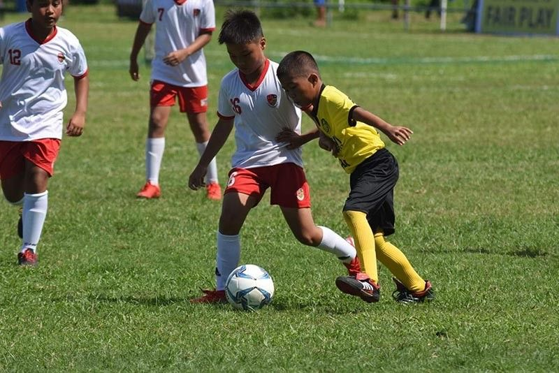 BACOLOD. Marawi ground zero player defends the ball against his opponent Claret School of Quezon City at Sta. Maria Football Field in Talisay on Thursday. (Contributed photo)