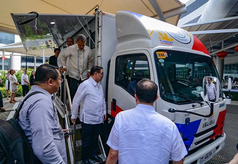 CHECKING IT TWICE. Foreign Affairs Secretary Teodoro Locsin Jr. inspects one of two mega vans at the SM Seaside City in February. (SunStar File Photo)