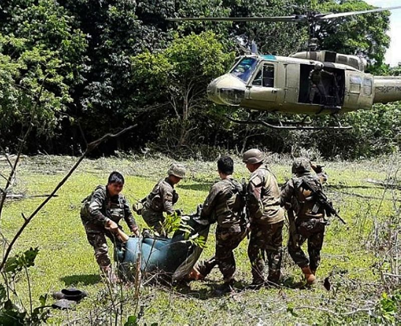 SULU. In this photo released by the Joint Task Force Sulu, soldiers carry bodies toward a military helicopter as pursuit operations continue in Patikul, Sulu, Friday, May 31, 2019. (AP)