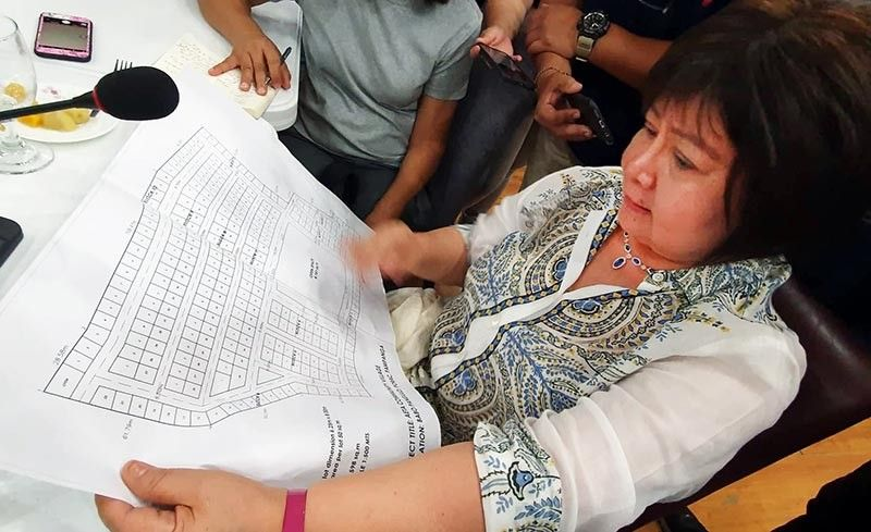 PAMPANGA. Pampanga Governor Lilia Pineda shows the plan for the construction of an Aeta Model Community, which will have 300 houses located in a 4,000-square meter land in Barangay Babo Pangulo, Porac, Pampanga. The Aeta families who will live here were displaced by the recent 6.1 magnitude earthquake. (Chris Navarro)