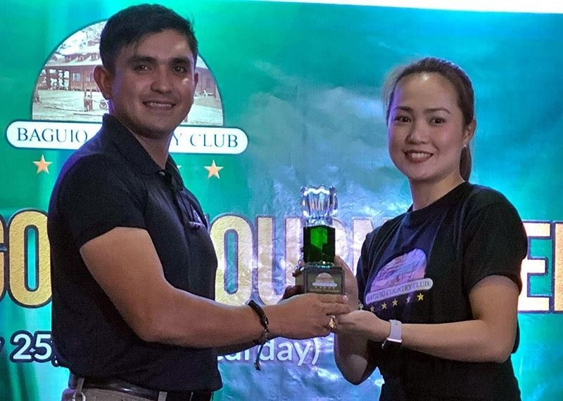 BAGUIO. Aaron Cadiogan receives his over-all title trophy from Baguio Country Club represented by Roane Galicia. (Contributed photo)