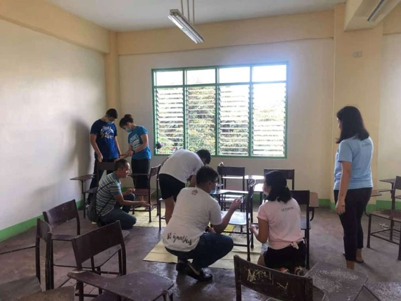 BACOLOD. Members of Saint John's Institute Student Council help prepare one of the classrooms of Negros Occidental High School in Bacolod City for the nationwide school opening on June 3, 2019. (Contributed Photo)