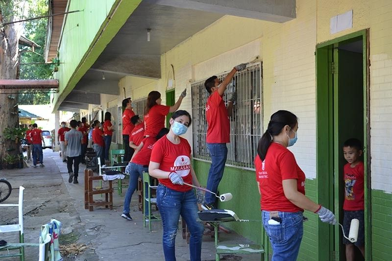 BACOLOD. The San Miguel Brewery employees shared their time and effort to help in the Brigada Eskwela project of the Department of Education held at Patricia Elementary School in Brgy. Granada, Bacolod City. (Contributed photo)