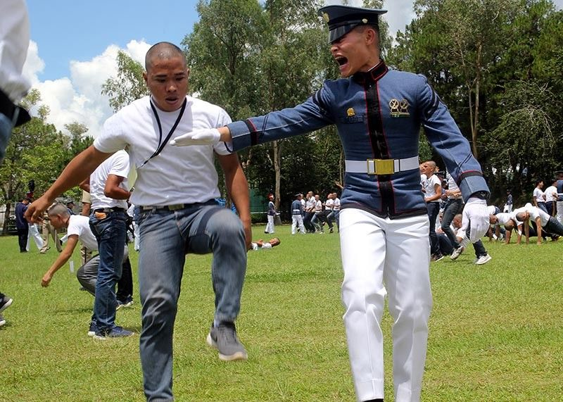 BAGUIO. A Philippine Military Academy plebe's physical and mental toughness is tested during the academy's reception rites at the Borromeo Field on June 1. (Photo by Jean Nicole Cortes)