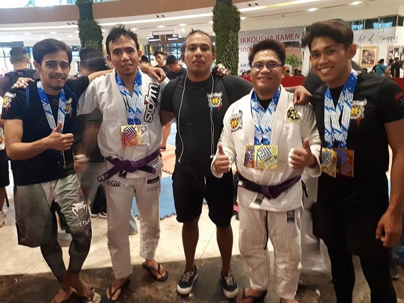 CEBU. From left, Jam Peralta, Francis de Guzman, Fidel Ballesteros, Jonathan Narisma, and Richard Romero of Deftac Davao team pose after their impressive showing in the Asia Pacific Jiu Jitsu Championship 2019 held at the Robinsons Galleria Cebu over the weekend. (Contributed photo)
