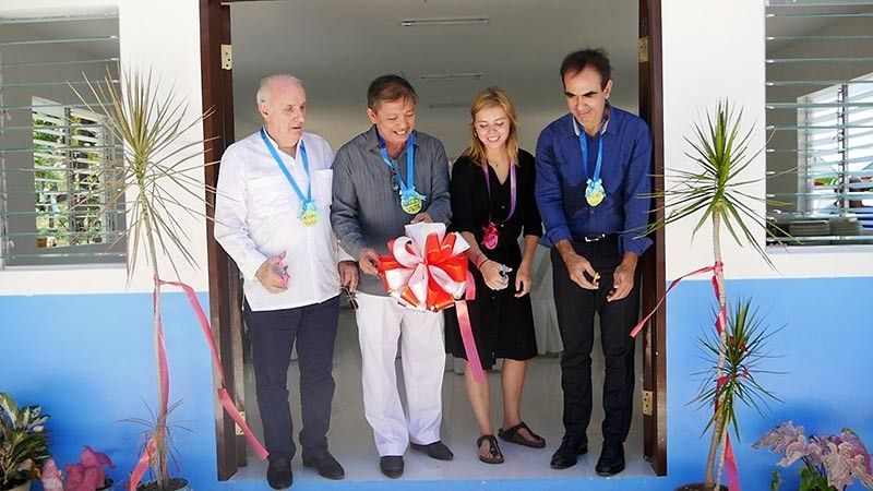 USEFUL CENTER. Officials of France-Philippines United Action Foundation inaugurate a multipurpose center in Barangay Cayang, Bogo City, northern Cebu. (Contributed photo)