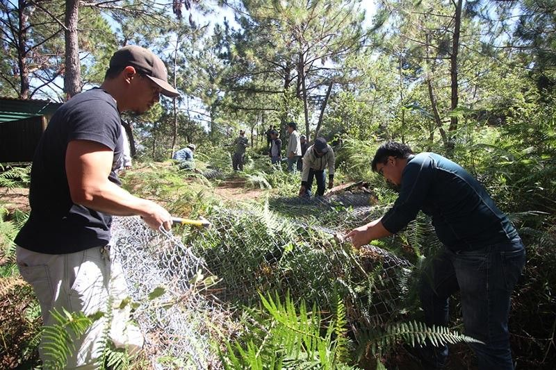 BENGUET. In this file photo taken January 2019, authorities confiscate construction materials from illegal settlers inside the Puguis La Trinidad Communal Forest in an effort to preserve and protect the forest. (Jean Nicole Cortes)