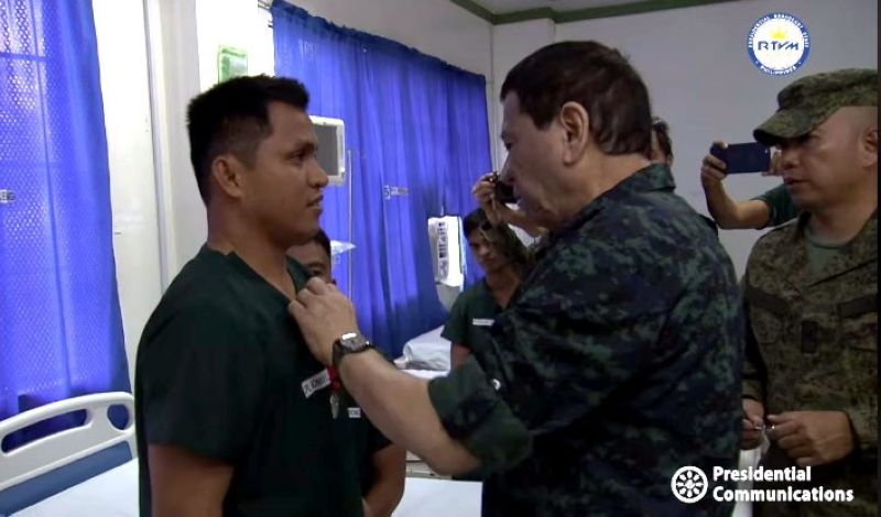 SULU. President Rodrigo Duterte visits the soldiers who were wounded-in-action (WIA) in a recent encounter against the Abu Sayyaf Group (ASG) at the Camp Teodulfo Bautista Station Hospital in Jolo, Sulu on June 4, 2019. He confers the Order of Lapu-Lapu with the Rank of Kampilan to 11 injured soldiers. Two with major injuries were airlifted to Zamboanga City. (Photo from RTVM video)
