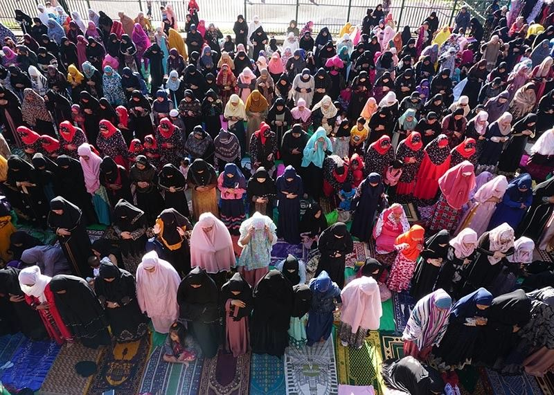 BAGUIO. Hundreds of Muslims gather at the Baguio Athletic Bowl as they offer prayers of praise and thanksgiving to Allah marking the end of the holy month of Ramadan or the Festival of breaking the fast. (Contributed Photo)