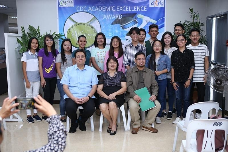 PAMPANGA. (Seated from L-R) Clark Development Corporation (CDC) president and CEO Noel F. Manankil, CDC Vice President for Administration and Finance Engr. Mariza Mandocdoc and CDC Assistant Vice President for External Affairs Rommel Narciso laud the student awardees from various schools during the CDC Academic Excellence Award held at the CDC Corporate Office Building 2112. (Contributed photo)