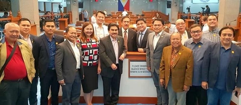 "MANILA. Bacolod City officials, led by Mayor Evelio Leonardia, Rep. Greg Gasataya, and Vice Mayor El Cid Familiaran pose with Senate President Vicente ""Tito"" Sotto III, Senator Juan Miguel Zubiri, and Senator Sherwin Gatchalian on September 10, 2018 when the Senate unanimously approved House Bill No. 7044, declaring June 18 of every year as the ""Bacolod City Charter Day."" On November 9, 2018, President Rodrigo signed the bill as Republic Act No. 11146 declaring June 18 as the correct date for ""Bacolod City Charter Day."" (Contributed photo)"