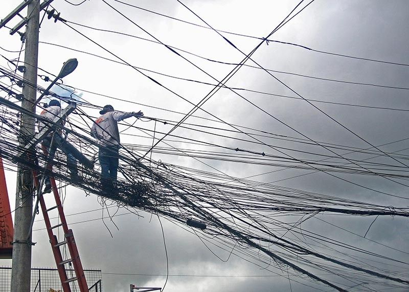 ENTANGLED. Cable and telecommunications companies congest in one post posing as a danger to residents and tourists in Baguio City. The Baguio Regreening Movement (BRM) called city officials to review an earlier proposed ordinance for an underground cable system in the Summer Capital.