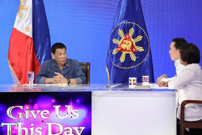 "DAVAO. President Rodrigo Duterte discusses matters during his guesting in the show ""Give Us This Day"" hosted by Kingdom of Jesus Christ founder and lead pastor, Apollo C. Quiboloy, at the Sonshine Media Network International (SMNI) Studio in Davao City on June 7, 2019. (Ace Morandante/Presidential Photo)"