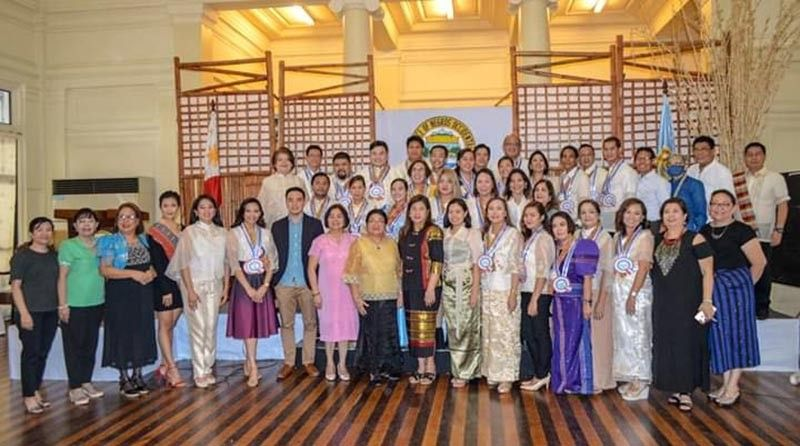 DOT-Western Visayas team led by Regional Director Helen Catalbas (ninth from left) with Provincial Supervising Tourism Operations Officer Cristine Mansinares (eight from right) and other provincial government officials, and 25 trained tour guides during their graduation rites at the Provincial Capitol's Social Hall in Bacolod City on Saturday. (Contributed photo)