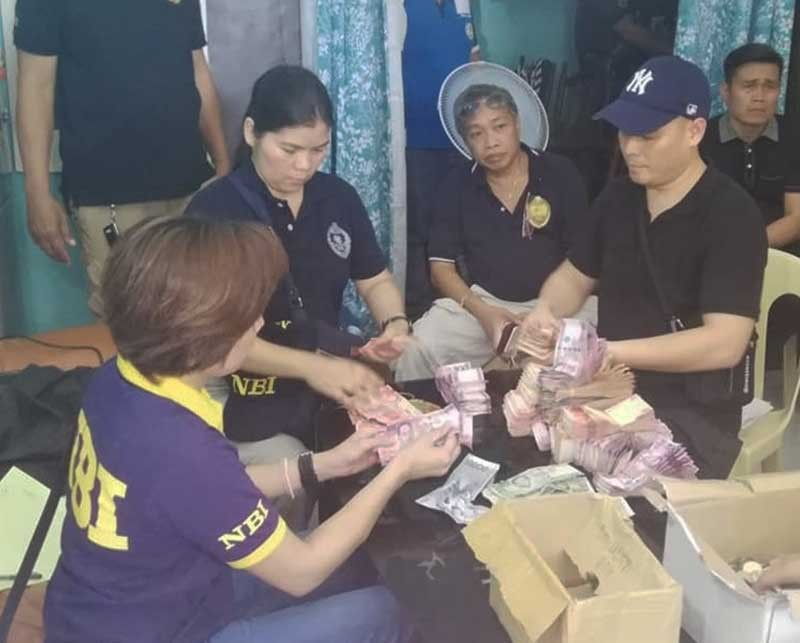 MISAMIS ORIENTAL. National Bureau of Investigation agents count bundles of bills found inside an office of the Kapa Community Ministry International Inc. in Opol, Misamis Oriental on Monday, June 10, 2019. (Photo by PJ Orias of SunStar Cagayan de Oro)