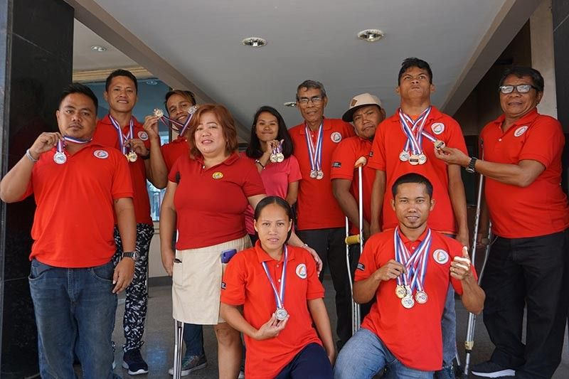 BACK-TO-BACK. The members of the Differently-Abled Talents, Entertainment and Sports (Dates) show their medals won at the 7th Philippine National Paralympic Games held last May 23 to 31 in Malolos, Bulacan. (SunStar photo / Alex Badayos)