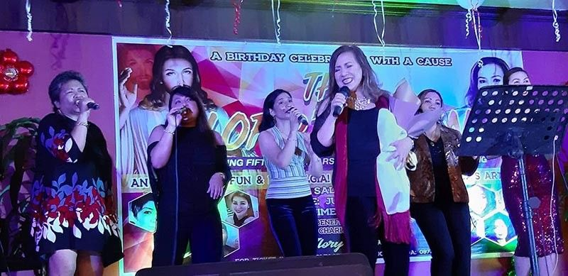 "BACOLOD. Charity Diva Token Lizares (4th from left) performs with her fellow singers during her 58th birthday concert for a cause dubbed as ""The Lord's Token"" held at Saltimboca, 15th Lacson Street, Bacolod City on June 8, 2019. (Carla N. Canet)"