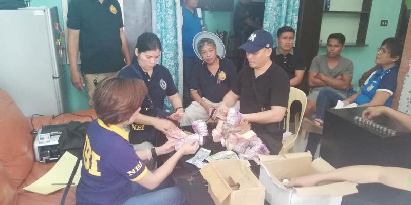 OPOL. National Bureau of Investigation (NBI) agents count large sums of money inside the Kapa office in Opol, Misamis Oriental on Monday, June 10, 2019. (PJ Orias)