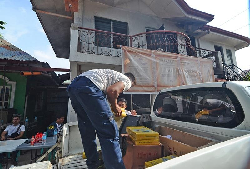 RAID. Agents of the National Bureau of Investigation in Central Visayas, in coordination with police, seize paraphernalia of Kapa-Community Ministry International Inc. in Barangay Poblacion, Compostela, Cebu on Monday, June 10, 2019, on the strength of a search warrant issued by Manila Regional Trial Court Judge Marivic Umali.  Securities and Exchange Commission lawyer Darwin Sotto (seated left) witnessed the raid. (SunStar photo / Alan Tangcawan)