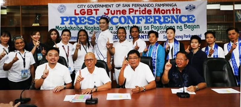 PAMPANGA. City of San Fernando Mayor Edwin Santiago, Vice Mayor Jimmy Lazatin, Councilor JB Lagman and Acting City Administrator lawyer Atlee Viray flash the Fernandino First sign with GAD head Amy Catacutan and Siwala President Randy Ocampo during LGBT June Pride Month press conference at the Levi Panlilio Conference Room, City Hall, CSFP, Monday, June 10, 2019. (Chris Navarro)