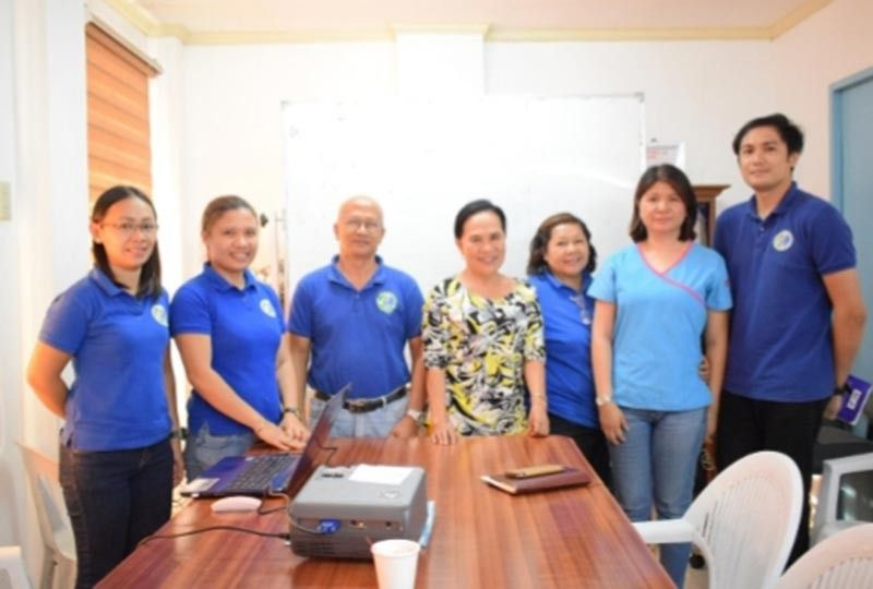 BACOLOD. Provincial Consultant on Research and Allied Concerns Engineer Marilyn Manuel (center) with laboratory personnel during the preliminary presentation of the latter's research works at the Provincial Veterinary Office in Bacolod City recently. (Contributed photo)