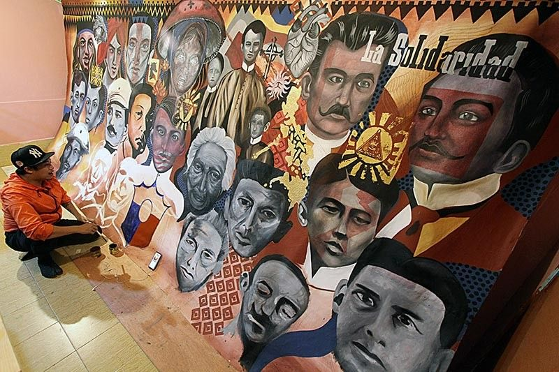 BAGUIO. A local artist paints a mural for Independence Day featuring Jose Rizal, Andres Bonifacio, Emilio Aguinaldo, Apolinario Mabini, Marcelo H. Del Pilar, Sultan Dipatuan Kudarat, Juan Luna, Melchora Aquino, Gabriela Silang among others as national heroes. The mural will be shown in an exhibit in Baguio Museum this Wednesday, June 12, 2019. Photo by Jean Nicole Cortes