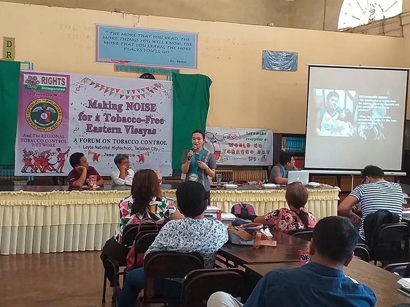 TACLOBAN CITY. Department of Health (DOH) Tobacco Prevention and Control manager Krystel Charisse Daya-Magos talks about smoking hazard during a forum on tobacco control at Leyte National High School in Tacloban City, June 11. At least 70 representatives from various sectors led by advocacy groups Rights Network and Katarungan-Leyte joined in the event. (Contributed photo)