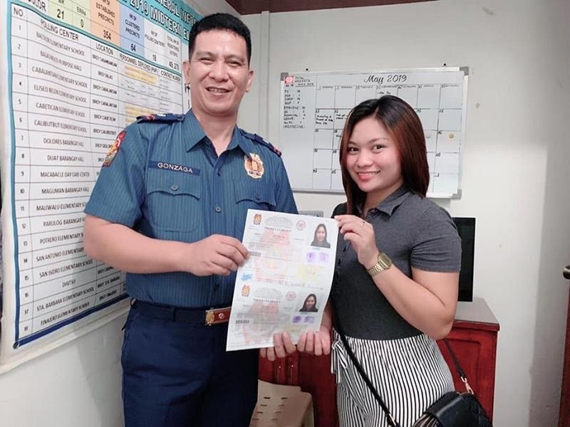 BACOLOR. Bacolor chief of police Major Louie Gonzaga poses with a fresh graduate who availed services under the First Time Job Seekers Assistance Act. (Contributed photo)