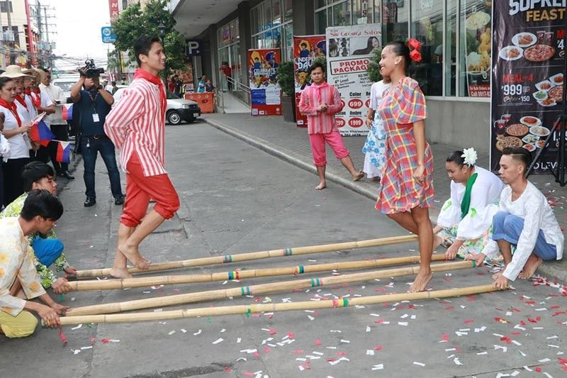"PAMPANGA. Cultural dancers perform the traditional ""tinikling"" during the Freedom Day celebration at SM City San Fernando Downtown. (Photo by Chris Navarro)"