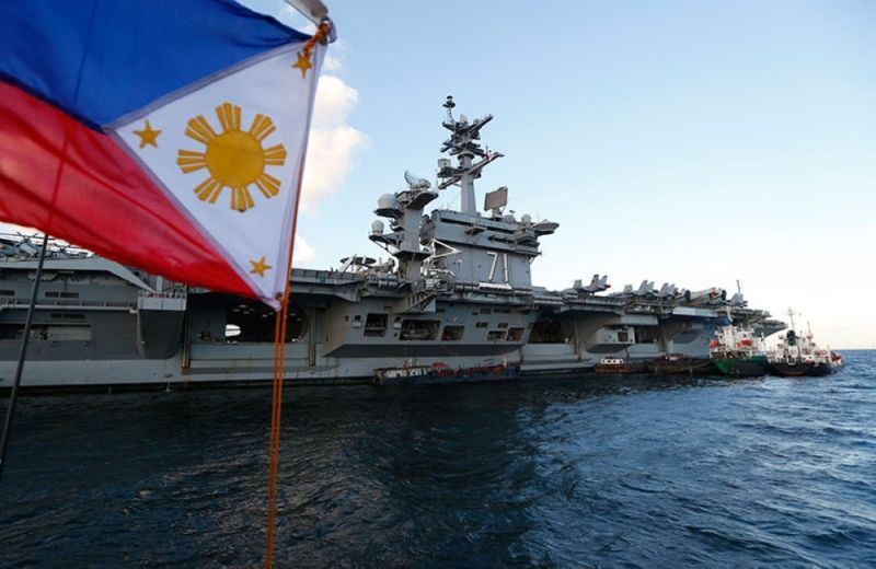WEST PHILIPPINE SEA. In this photo taken in April 2018, U.S. aircraft carrier Theodore Roosevelt (CVN-71) and several escort ships sailed in the South China Sea in a display of America's naval might during the Chinese sea drills. (File Photo)