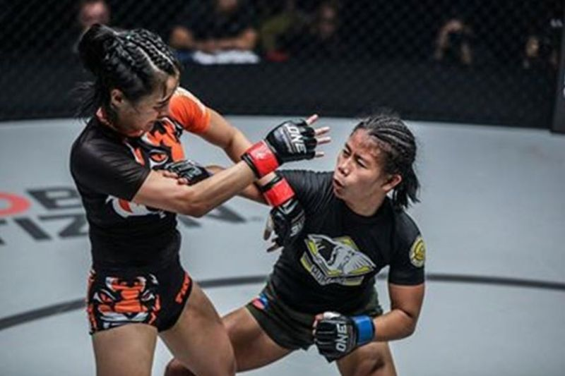 Angelie Sabanal of Cagayan de Oro connects a straight punch against Rika Ishige of Thailand in her first ONE Championship fight. (Photo by ONE Championship)