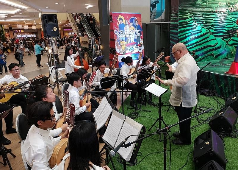 """BAGUIO. The University of Baguio Rondallia Ensemble presents and showcases classical Filipino compositions that withstood time and is getting a revival through the """"School of Living traditions"""" being reintroduced in schools throughout the Cordillera Region. (Photo by Dave Leprozo Jr.)"""