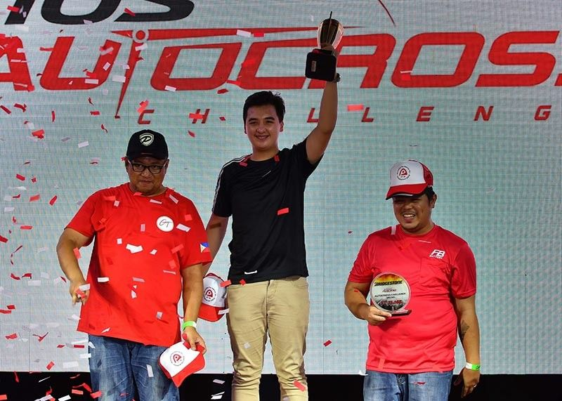 BAGUIO. Iñigo Anton top the podium after dominating the 2nd Vios Autocross Challenge at the Clark International Speedway. Aside from a champion racer, Anton is also an achiever in school. (Photo by Jon Gonzales)