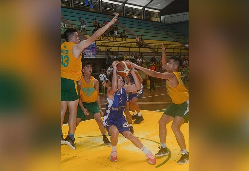 TRIPLE TEAM. A player from Hotel Fortuna/UC finds himself alone against three defenders from USC during their Partners Cup game. (SunStar Photo/Arni Aclao)