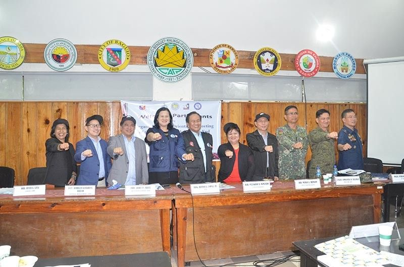 BAGUIO. Officials of the National Task Force to End Local Communist Armed Conflict (NTC-ELCAC) headed by Cabinet Officer for Regional Development (CORD) for Cordillera and Department of Budget and management officer-in-charge Undersecretary Janet Abuel and National Security Adviser Deputy Director General Rufino Lopez Jr. and Cordillera Regional Development Council members affirm their partnership and convergence in pushing for peaceful and progressive communities. (Photo by Lito Dar)
