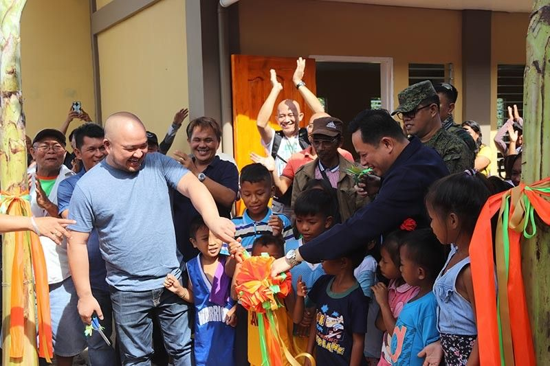 DAVAO. Ribbon-cutting of the new school building comprised of two classrooms that will benefit 62 students.
