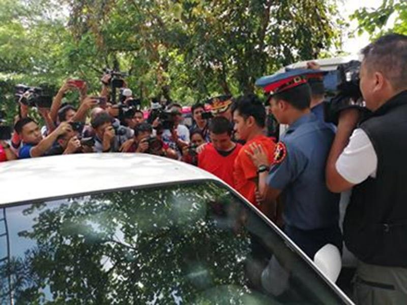 MANILA. Two suspected terrorists, in orange, are escorted into a police car on Monday, June 17, 2019, in Quezon City. (Photo by Third Anne Peralta-Malonzo)