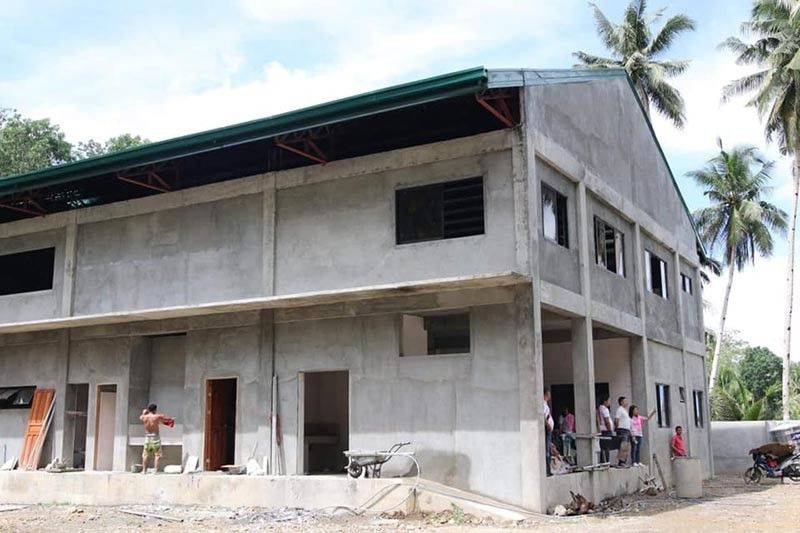 LEYTE. Maasin City Mayor Nacional Mercado (center) inspects the ongoing construction of a permanent evacuation center in Barangay Rizal. (Contributed photo)