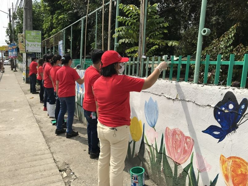 BACOLOD. CCBPI-Bacolod associates help painting the façade of the Antonio L. Jayme Elementary School in Barangay Mansilingan, Bacolod City during this year's Brigada Eskwela. (Contributed photo)
