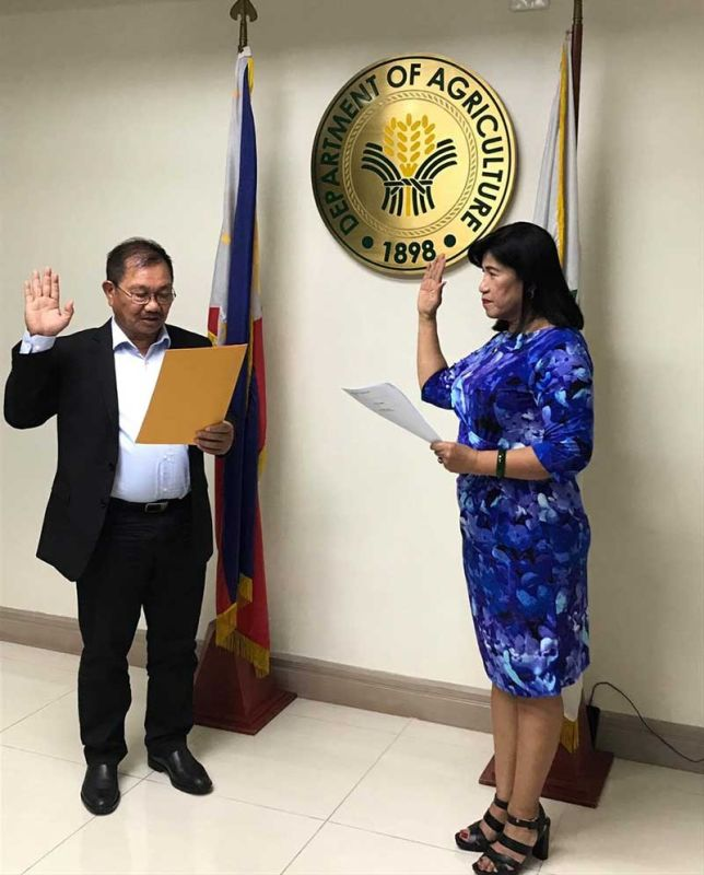 MANILA. Judy Carol Dansal takes her oath as new National Food Authority (NFA) chief before Agriculture Secretary Emmanuel Piñol on June 18, 2019. (Contributed Photo)