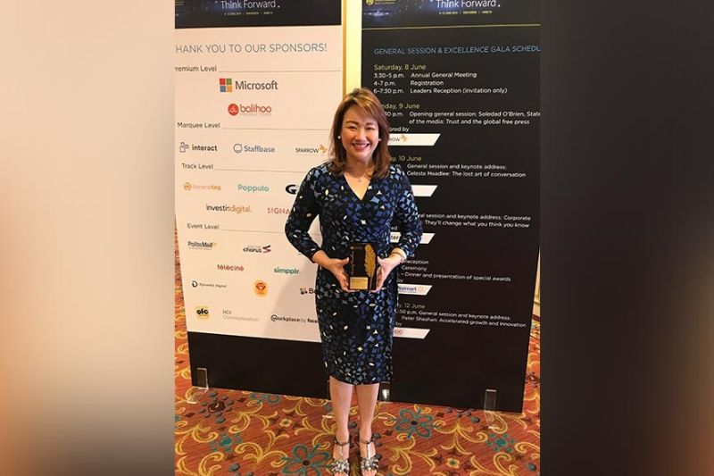WINNER. Maricar Bautista, Aboitiz Equity Ventures assistant vice president-Media Relations, receives the award on behalf of the Aboitiz Group. (Contributed photo)