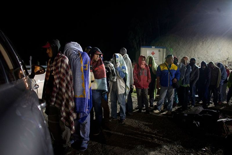 COLOMBIA. In this August 31, 2018 file photo, Venezuelan migrants line  up for free bread and coffee, donated by a Colombian family from their car, at a gas station in Pamplona, Colombia. (AP)