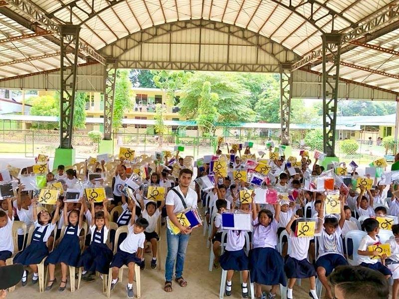 PAMPANGA. Barangay Tabuyuc, Apalit SK Chairman EJ Salonga poses with recipients of