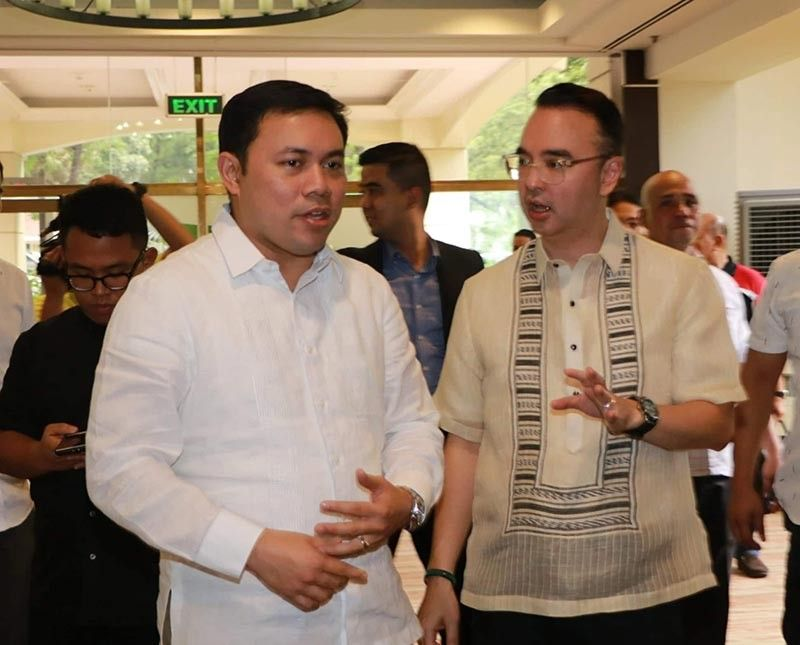 PAMPANGA. Department of Public Works and Highways Secretary Mark Villar and Taguig Representative Allan Peter Cayetano exchange views and opinions during Tuesday's Forum dubbed