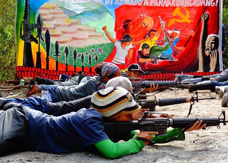 CORDILLERA. Members of the New People's Army in the Cordillera region undergo firearms training. Just recently, four NPA rebels surrendered to the government in Ifguao province. (Contributed photo)