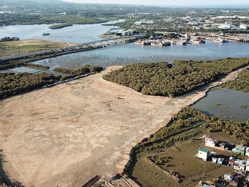 PROBE. An aerial shot shows the mangrove area in Paknaan, Mandaue City facing Cansaga Bay, where a developer has allegedly cut some mangrove trees. (SunStar photo / Allan Cuizon)