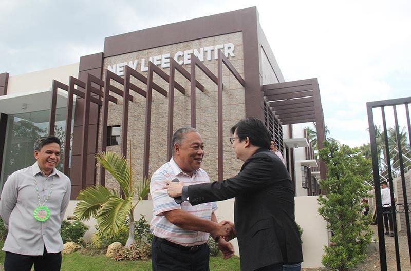 NEW FACILITY. Cebu Gov. Hilario Davide III (center) welcomes Presidential Assistant for the Visayas Michael Dino (right) at the inauguration of the Project New Life Center in Pinamungajan town. (SunStar photo / Amper Campaña)