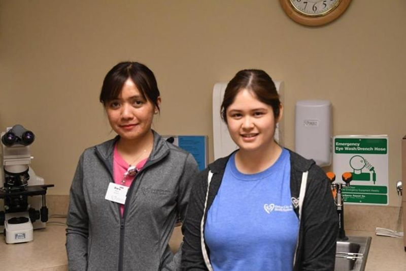 IOWA. Dara Daynos and Kathleen Gaabucayan work as lab technicians at the Orange City Area Health System. Originally from the Philippines, they were recruited after the hospital did not receive applicants for open positions in the lab. (Photo by Randy Paulson)