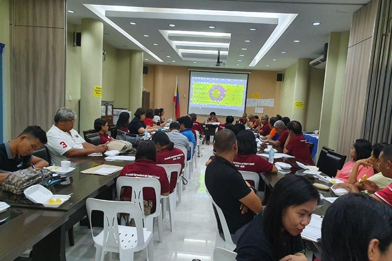 AKLAN. Officers and members of the Aklan Provincial Agriculture and Fisheries Council discussing their concern on the revival of an advocacy against burning of rice straws in the province. (Jun N. Aguirre)